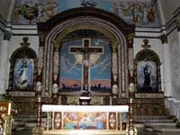 The altar of Immaculate Conception Church in Bauan - Places to see